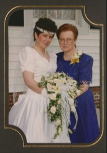 Mom and me at my wedding.  She was no longer nursing at this point, but she had not yet come down with the condition that would eventually claim her.